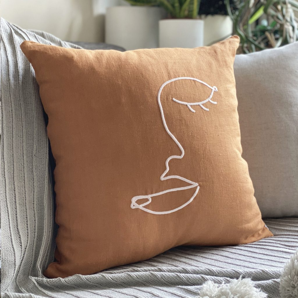 Embroidered Face Art Linen Cushion